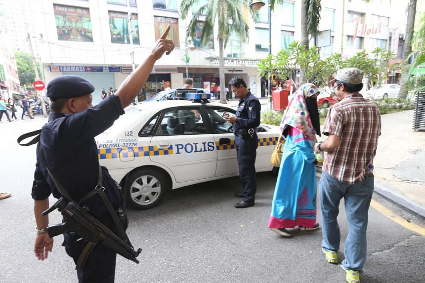 Security was beefed up around Low Yat Plaza (above) yesterday following rumours of some groups planning unrest there.