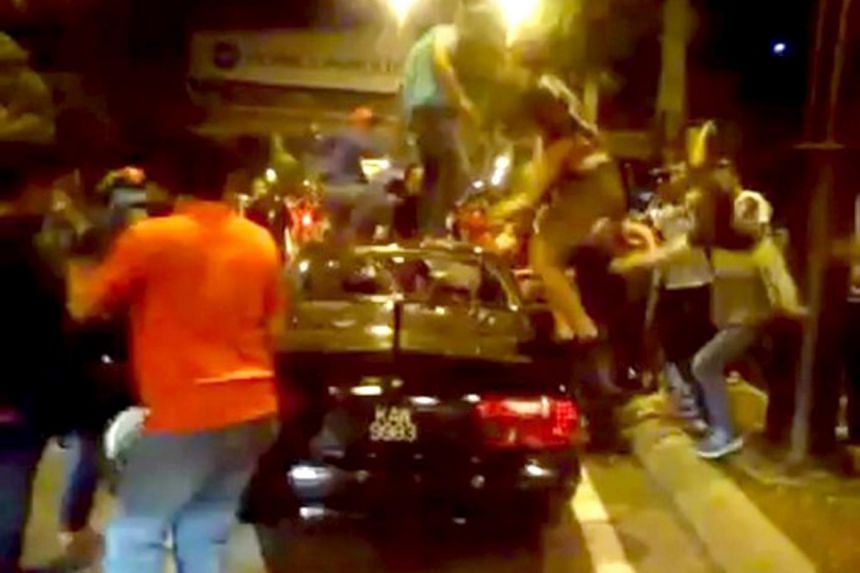 A mob smashing and jumping on a car last Sunday in a video that went viral.