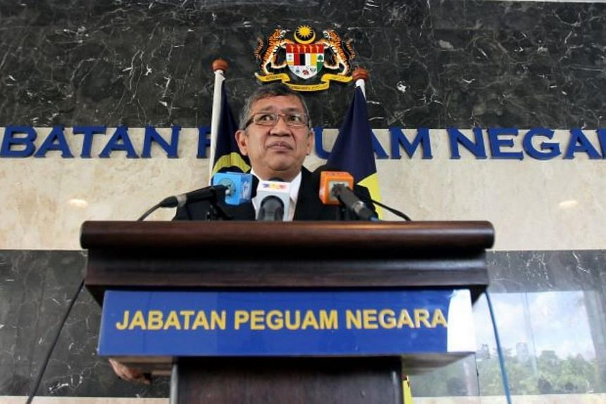 Malaysian Attorney-General Abdul Gani Patail has filed a defence more than a year after two legal suits were filed against him.