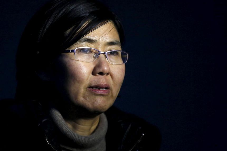 Human rights lawyer Wang Yu talks during an interview with Reuters in Beijing.