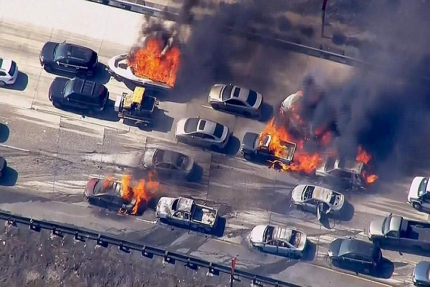 A raging brush fire in California overran the Interstate 15 freeway in mountainous Cajon Pass in California on Friday, burning 20 vehicles and forcing people to scramble to safety. Hundreds of firefighters battled yesterday to contain the fire which