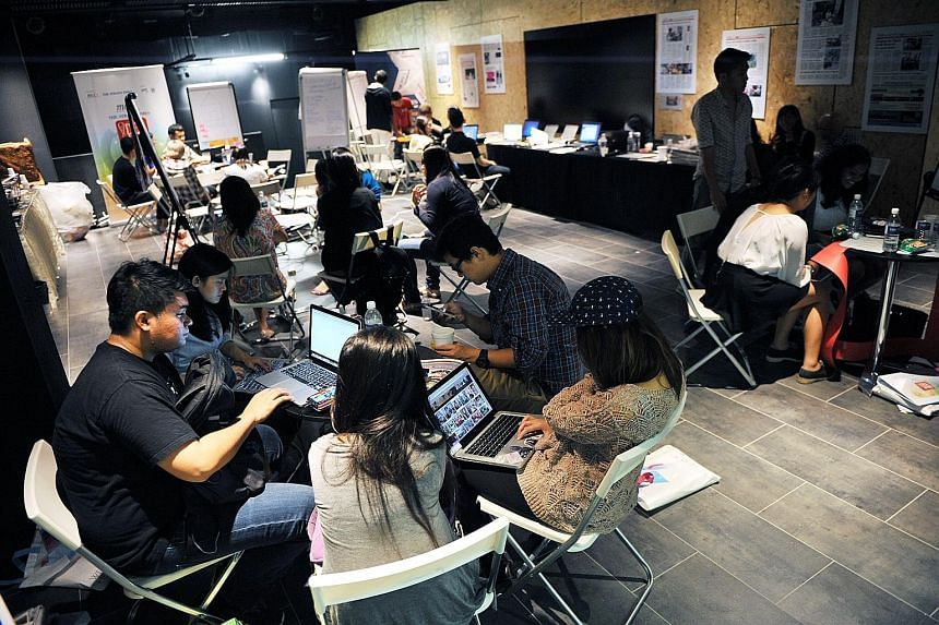 MCCY-Straits Times Idea Jam participants preparing for their presentations last October. With the help of ST journalists, participants shaped their ideas for various non-profit groups, learning about research and interviewing, before pitching them to