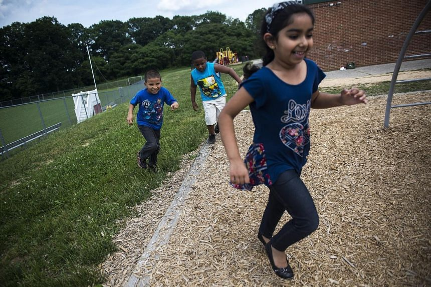 Kindergartners during recess at a Baltimore district school, where the new curriculum for five-year-olds will integrate time for play. After focusing on raising test scores in maths and reading, more school districts in the US are embracing play as a