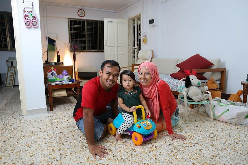 Mr Muhammad A'srie Che Ali, his wife Jaclyn and their daughter Maryam, at the three-room flat in Dover that they have been renting.