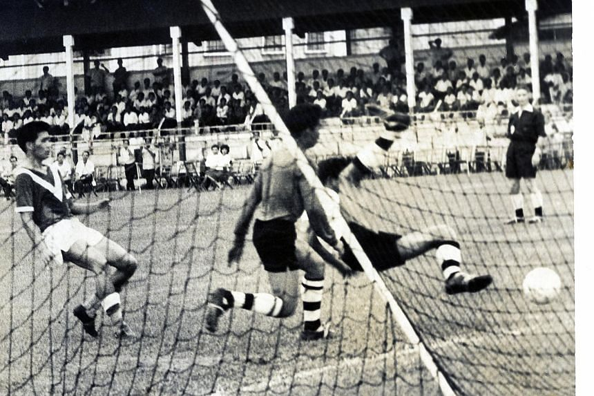 Quah Kim Swee (above), who scored against Pahang in a 1963 match in this photo, was known for his bravery in attempting headers.