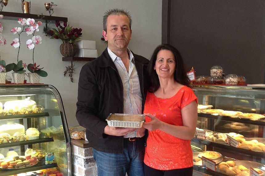 Greek-Australian Con Hassiotis, (above, with his wife) saw only a bleak future in Greece, so he moved his family and pie-making business to Sydney, Australia in 2012.