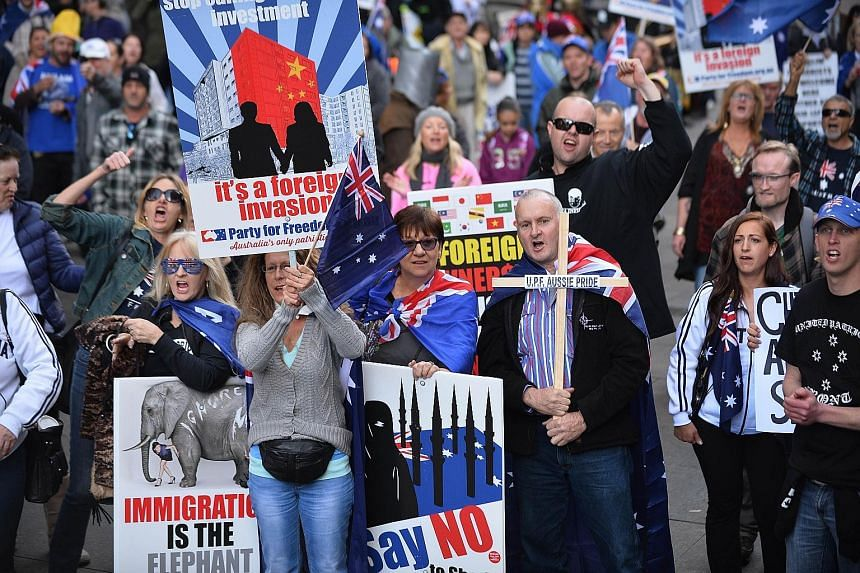 Nationalist protesters at a Reclaim Australia rally in Sydney yesterday. Similar rallies were held in other Australian cities. There were also anti-racism protests.