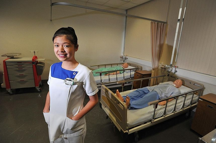 Ms Lim Ling in a simulated hospital ward at NYP, where she is studying nursing.