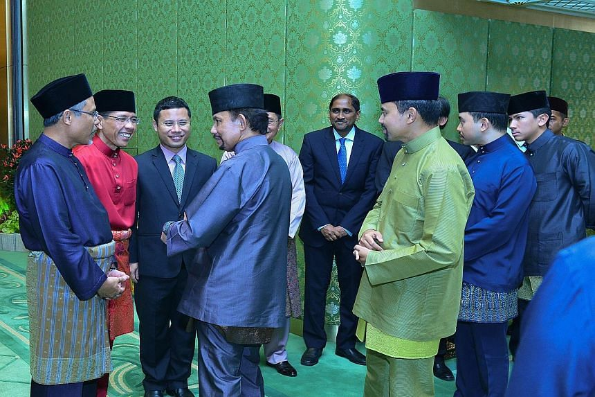 Minister in the Prime Minister's Office and Second Minister for Foreign Affairs and Home Affairs Masagos Zulkifli (left) conveying Hari Raya greetings on behalf of Singapore's leaders to Brunei Sultan Hassanal Bolkiah, as well as members of the royal