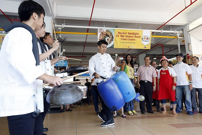 Moutbatten MP Lim Biow Chuan (fourth from right), along with representatives from the Singapore Tourism Board and the Old Airport Road (51) Merchants Association, watching musicians put on a show using pots, plastic barrels and other cooking ware at