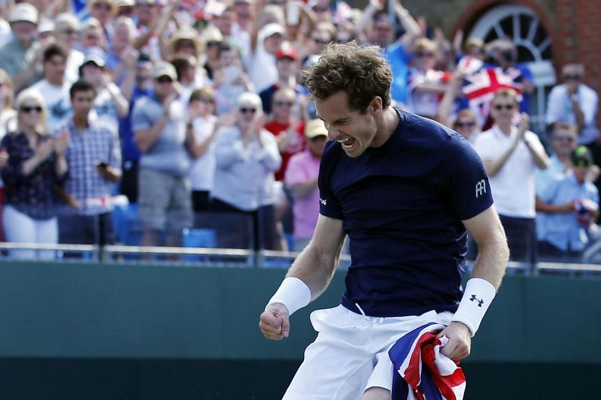 Andy Murray jumping in joy after his win over Gilles Simon sent Britain into the Davis Cup semi-finals.