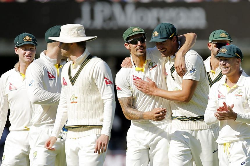 Australia's cricketers celebrating after their win over England.