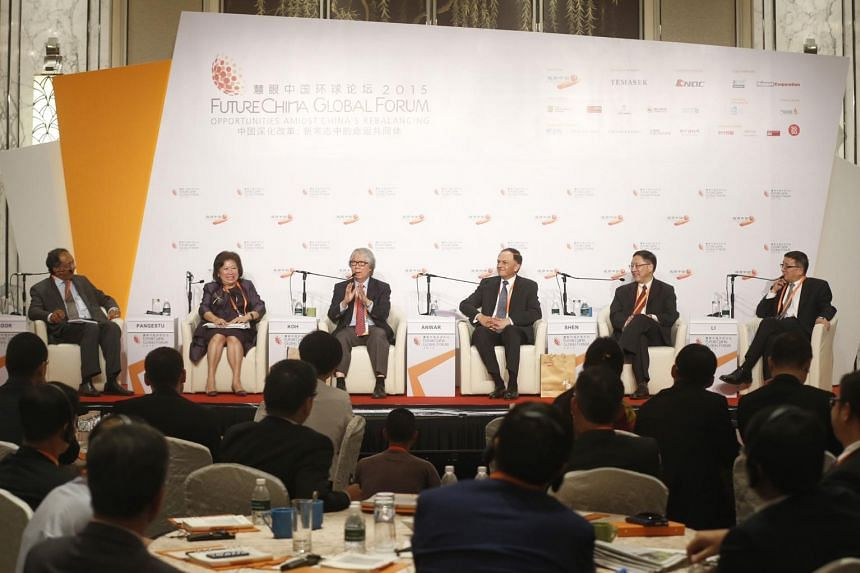A panel discussion titled 'China as a challenger AND as part of the existing world order: What does this mean for meeting global challenges' at the FutureChina Global Forum at Shangri-La Hotel on 20 July 2015. Seen at the discussion are (from left to
