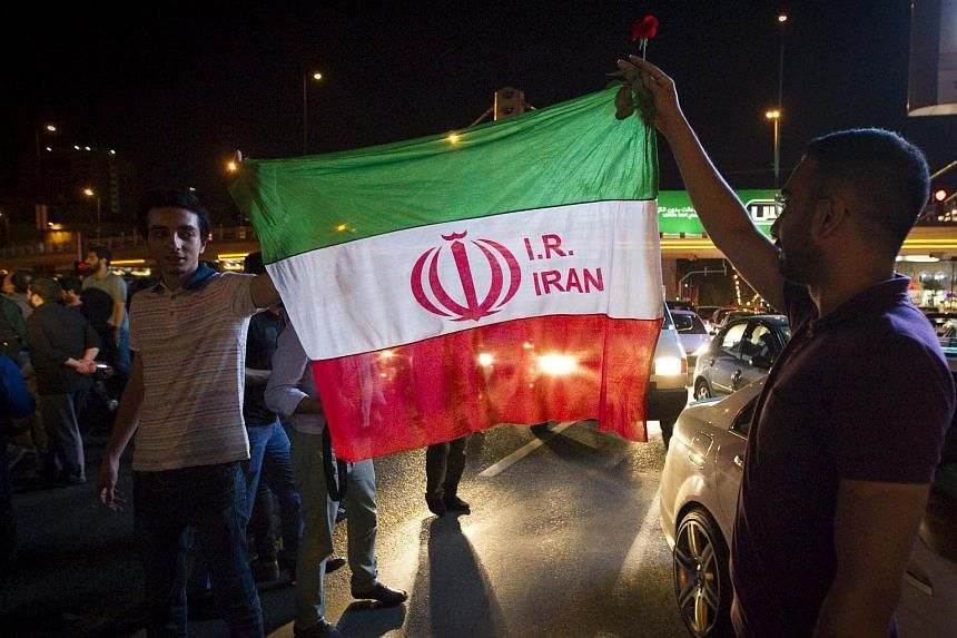 Iranians celebrate on the streets following a nuclear deal with major powers, in Tehran on July 14, 2015. PHOTO: REUTER