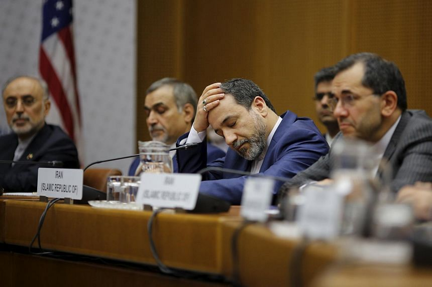 A member of the Iranian delegation reacts during a plenary session at the United Nations building in Vienna, Austria.
