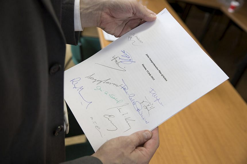 Martin Schaefer, press officer of the German Foreign Ministry holds a signed copy of the Joint Comprehensive Plan of Action regarding Iran's nuclear programme.