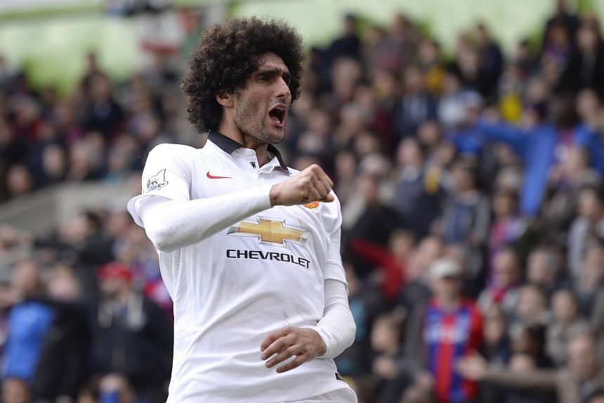 Manchester United's Marouane Fellaini celebrates scoring their second goal in a  Barclays Premier League match between Crystal Palace and Manchester United.