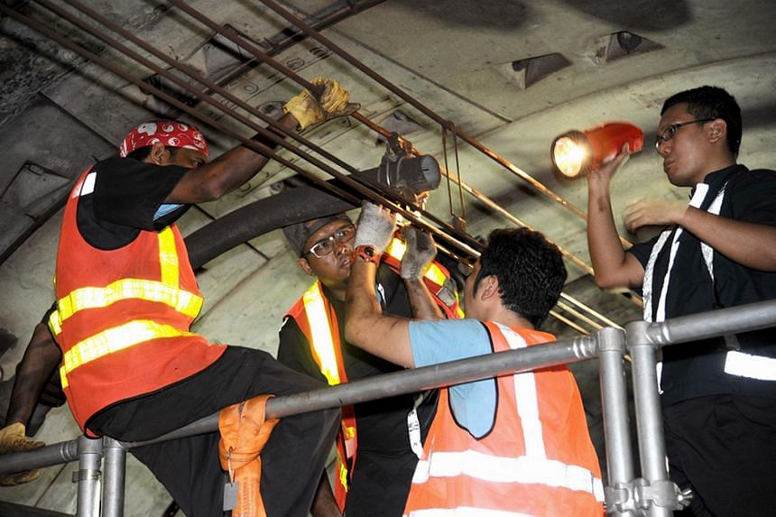 Engineers working to resolve the problem in the tunnel during the MRT breakdown along the North-East Line (NEL) between Habourfront and Dhoby Ghaut stations on March 15, 2012.