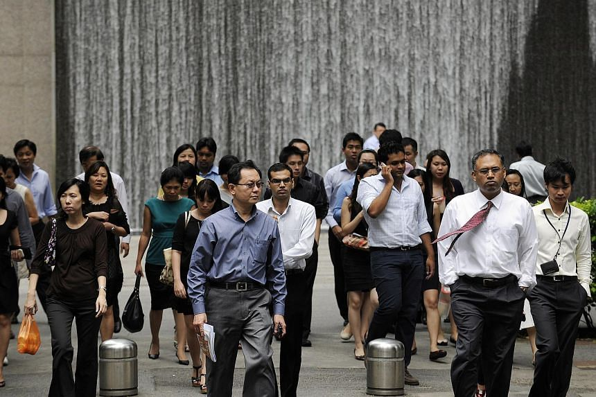 Office workers walk through the central business district during lunch break.