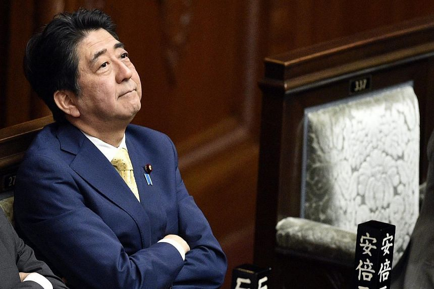 Japanese Prime Minister Shinzo Abe looks up during a House of Representatives plenary session on the controversial security bills at the parliament in Tokyo.