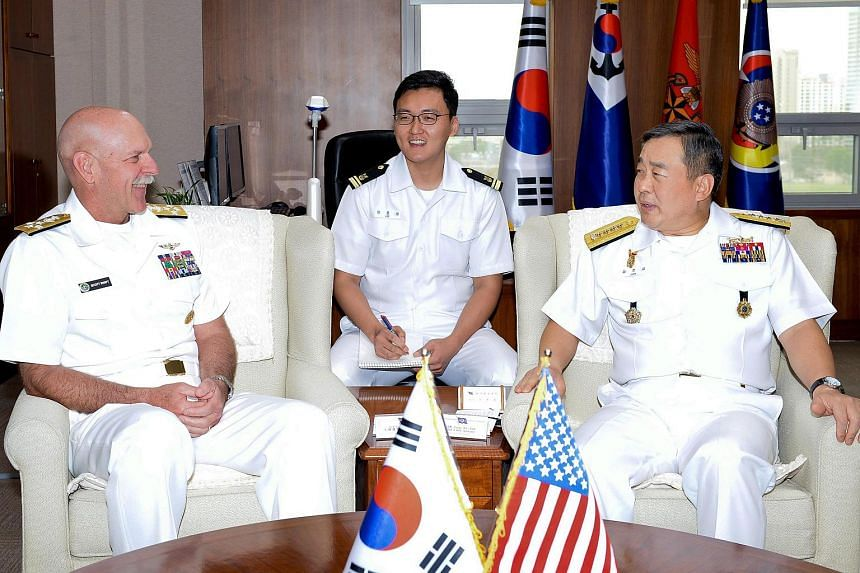 A handout image released by the South Korean Navy of South Korean Navy Chief of Staff Chung Ho Seop (right) talks with US Admiral Scott Swift, the new US commander of the Pacific Fleet, during their meeting in Seoul, South Korea on July 20, 2015.