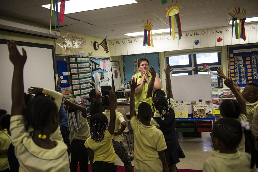 Kindergartners during recess at a Baltimore district school, where the new curriculum for five-year-olds will integrate time for play. After focusing on raising test scores in maths and reading, more school districts in the US are embracing play as a bedr