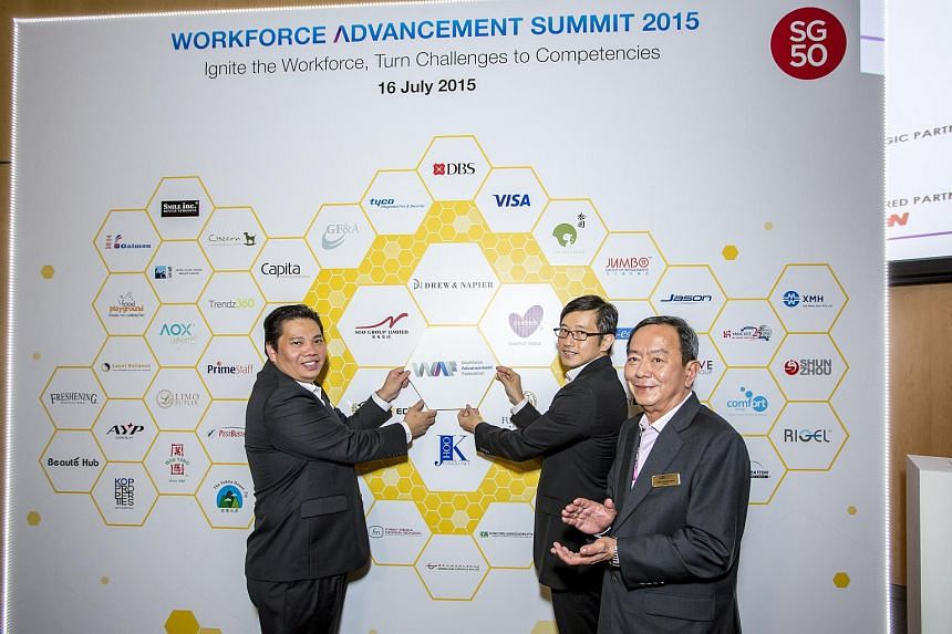 (From left) Neo Kah Kiat, WAF vice-chairman, Teo Ser Luck, Minister of State for Trade and Industry and Chan Chong Beng, WAF chairman, jointly launching the Workforce Advancement Federation.
