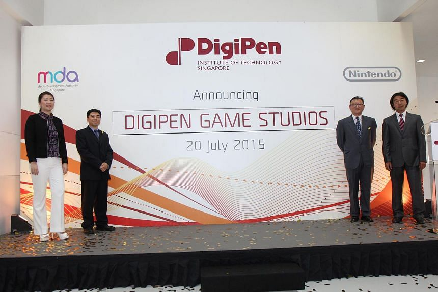 (From left) Ms Angeline Poh, Assistant Chief Executive (Industry),  Mr Jason Chu, Chief Operating Officer – International, DigiPen, Mr Tan Chek Ming, Managing Director, DigiPen (Singapore), Mr Takao Yamane, General Manager of Licensing, Nintendo.
