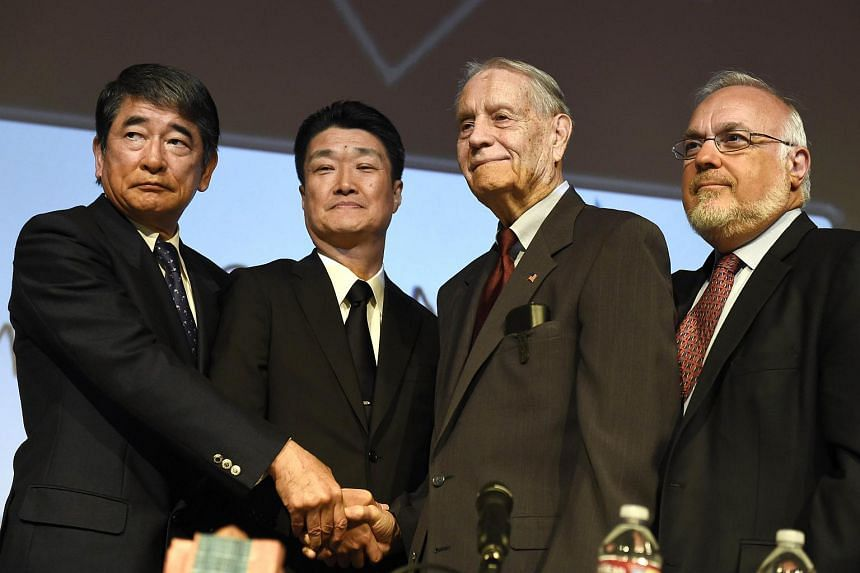 American World War II prisoner of war James Murphy (second right) shakes hand with Hikaru Kimura, Mitsubishi Materials Corp. senior executive, and Yukio Okamoto (left), Mitsubishi Materials Corporation outside board member, next to Rabbi Abraham Coop
