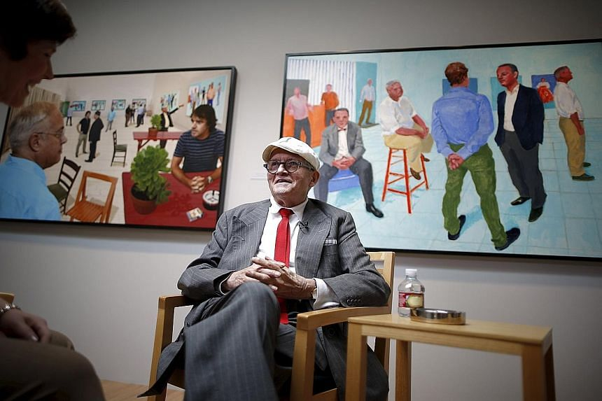 Artist David Hockney in front of his artwork The Red Table (far left) and The Group V (left).