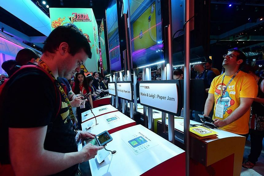 Fans playing on Nintendo 3DS at the Electronic Entertainment Expo in Los Angeles last month. At the DigiPen studios here, developers will be mentored and assisted to develop titles for the 3DS platform.