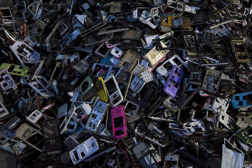 Some of Guiyu's e-waste workers recycling CD players. Many workers strip apart electronic devices with their bare hands or melt the plastic circuit boards to salvage bits of valuable metals with little protective gear. An enormous amount of e-waste p