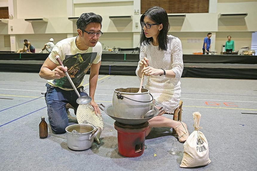Co-stars Adrian Pang,who plays Mr Lee Kuan Yew, and Sharon Au as Mr Lee's wife Kwa Geok Choo, rehearsing a scene in which Madam Kwa encourages Mr Lee in his development of a tapioca-based glue, which he named Stikfas, during the Japanese Occupation
