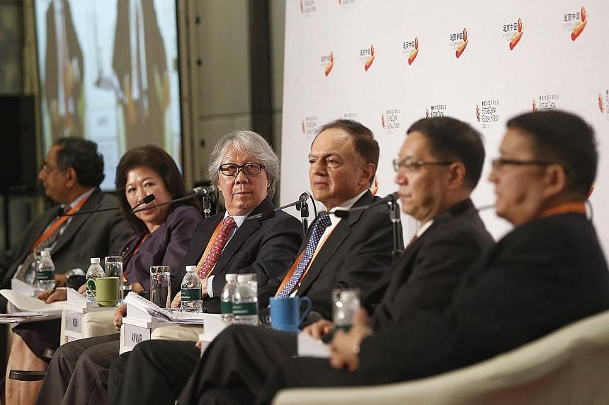 Straits Times associate editor Ravi Velloor (left) with panellists (from left) Professor Mari Pangestu, Ambassador-at-Large Tommy Koh, Mr Yaseen Anwar, Professor Shen Dingli and Mr Li Cheng, during yesterday's session on China as a challenger and a p