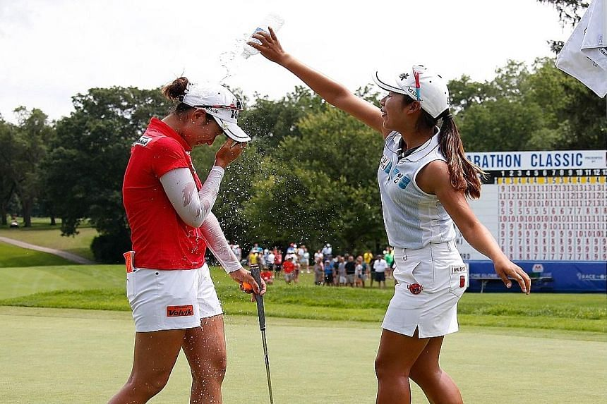 Chella Choi gets water poured on her by fellow South Korean Lee Mi Hyang after winning the Marathon Classic, her first LPGA Tour title.