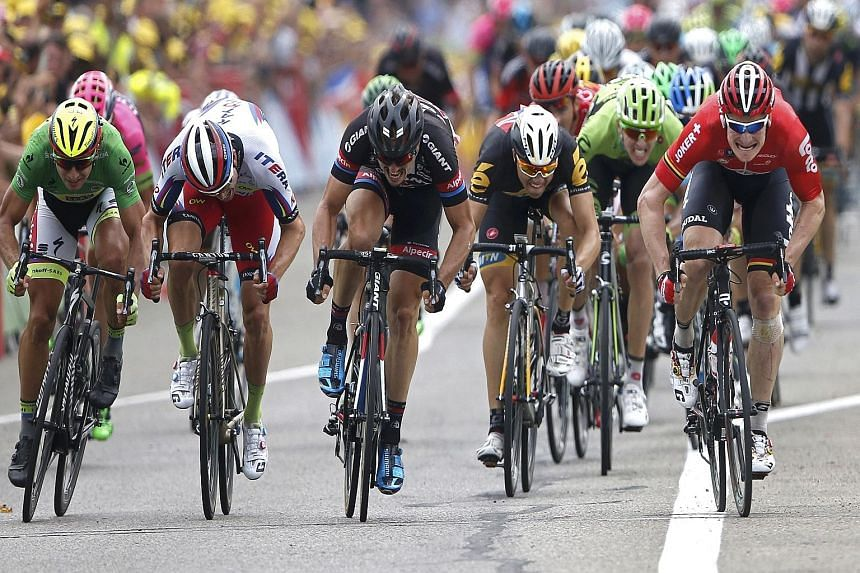 """Lotto-Soudal rider Andre Greipel of Germany (right) sprinting to win the 183km 15th stage of the Tour de France from Mende to Valence on Sunday. The burly rider is known as the """"gorilla of Rostock"""". The list of colourful nicknames for the leading cyc"""