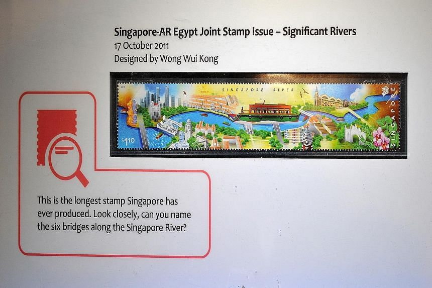 A first-day cover with stamps featuring the 1966 National Day Parade; the original artwork of the first stamp to be issued by the Republic in 1966; a printing plate of the 1999 stamp featuring Singapore's first president, Mr