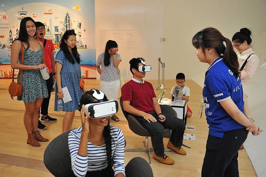 Visitors using equipment to experience virtual reality at the Singapore STories: Then. Now. Tomorrow exhibition at the ArtScience Museum.