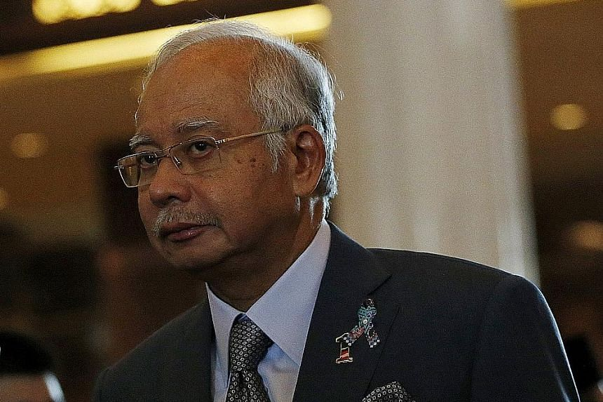 It is business as usual for Prime Minister Najib Razak, even as others around him are busy fighting fires.
