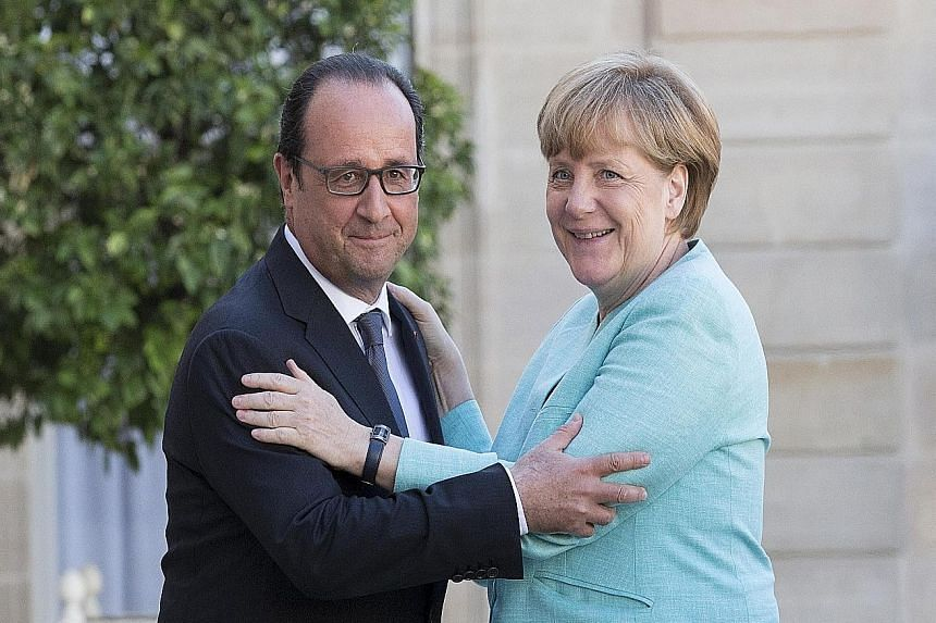 """French President Francois Hollande meeting German Chancellor Angela Merkel in Paris earlier this month. Mr Hollande says Europe has let its institutions become weaker and that there should be a """"government of the euro zone (with) a specific budget as"""