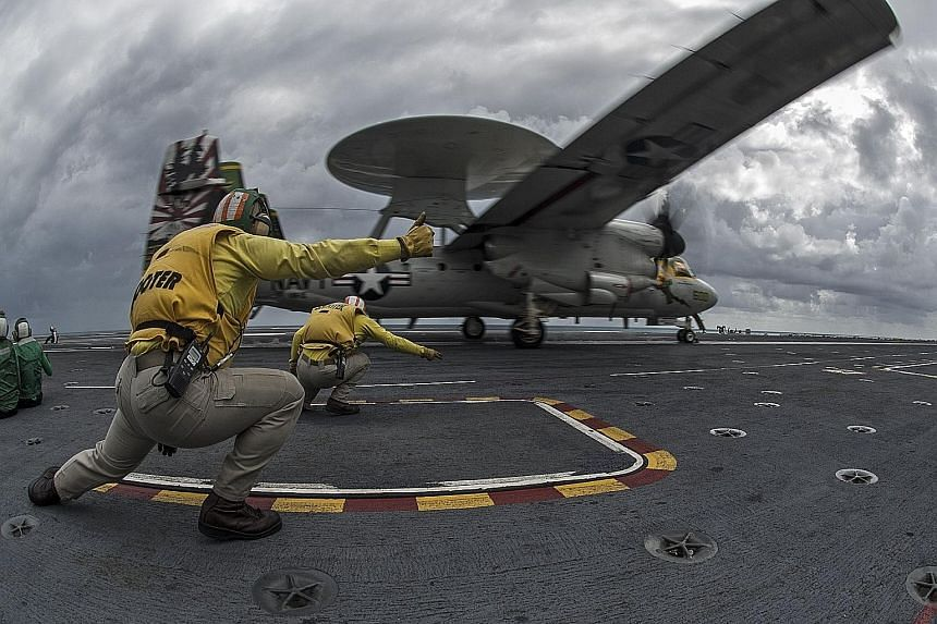 An E-2C Hawkeye plane taking off from the Nimitz-class aircraft carrier USS George Washington earlier this month during Exercise Talisman Sabre, held off the north coast of Australia.