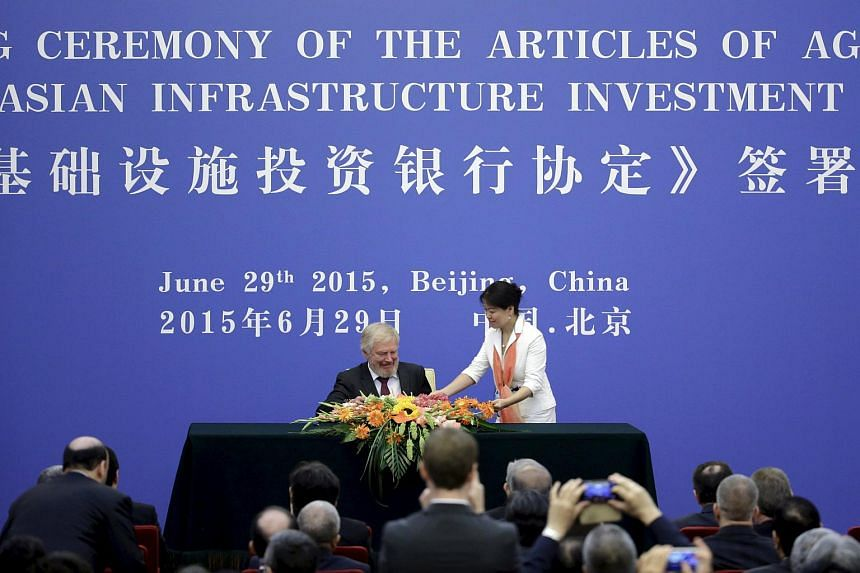 Russia's delegate prepares to sign the articles of agreement of the Asian Infrastructure Investment Bank (AIIB) at the Great Hall of the People, in Beijing.