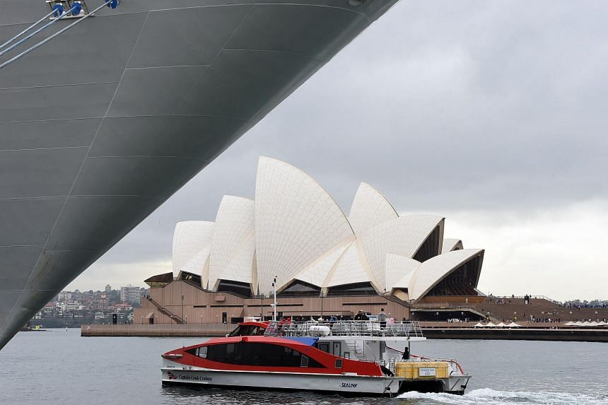 A boat carries tourists in front of the Sydney's landmark Opera House. Australia's unions are facing a serious crisis following a series of damaging scandals and an explosive royal commission.