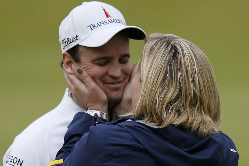 Johnson being congratulated by his wife Kim Barclay.