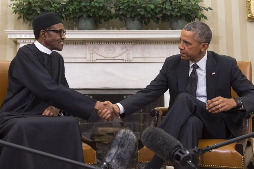 US President Barack Obama (right) shaking hands with his Nigerian counterpart Muhammadu  Buhari in the White House.