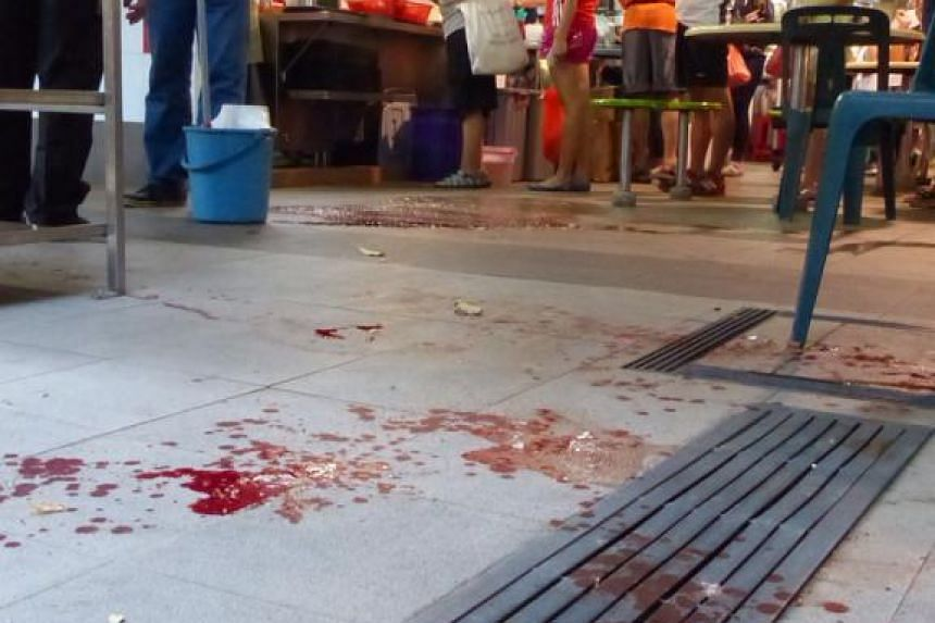 A trail of blood at the hawker centre at Blk 538, Bedok North Street 3, after a man who was attacked in a slashing incident ran into the hawker centre.