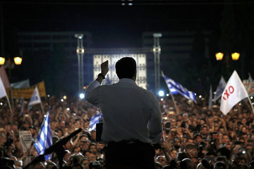 Greek PM Alexis Tsipras delivering a speech at an anti-austerity rally in Athens.
