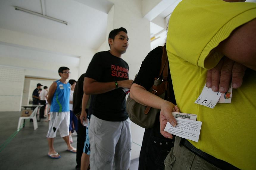 Voters queuing at a polling station during the 2011 General Election.