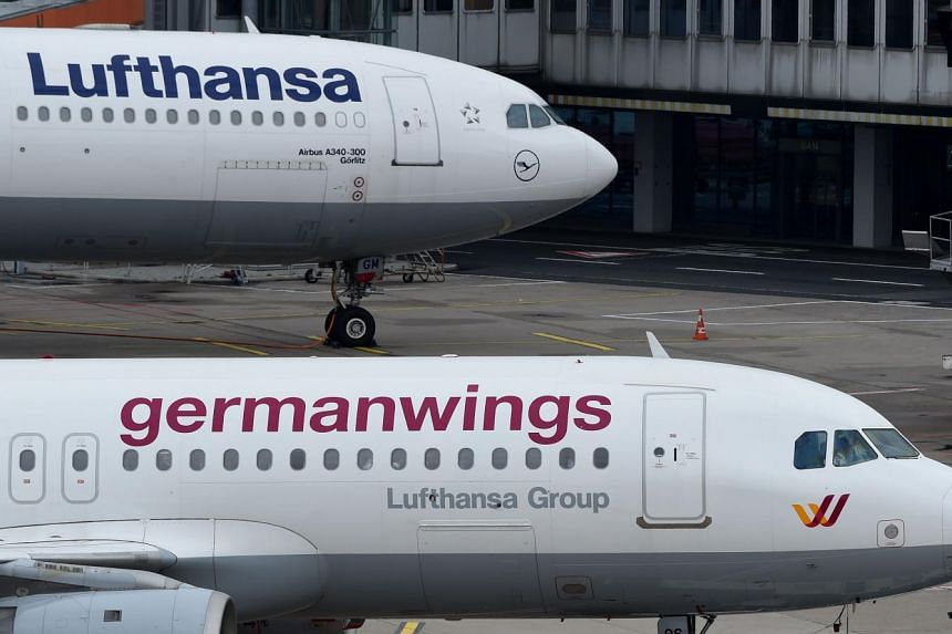 An Airbus plane of German airline Lufthansa (top) and a plane of the company's Germanwings subsidiary at the Duesseldorf airport.
