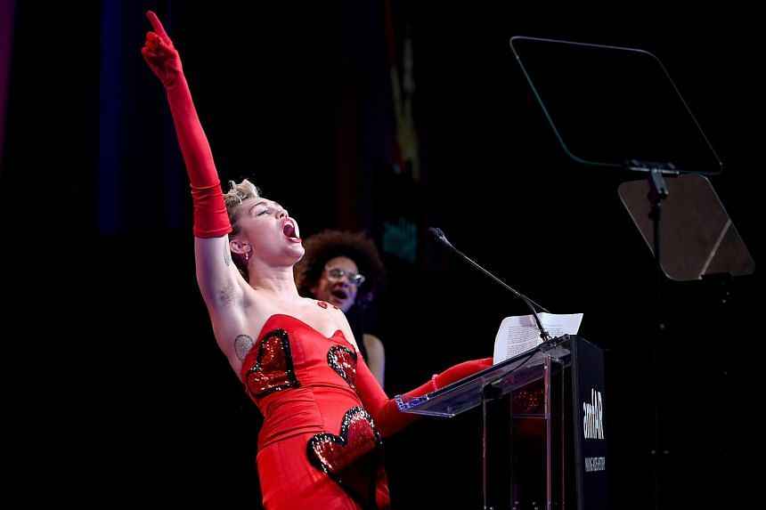 Miley Cyrus speaks onstage at the 2015 amfAR Inspiration Gala New York at Spring Studios on June 16, 2015 in New York City.